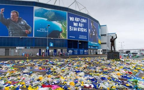 Tributes continue to be left to Emiliano Sala at the Cardiff City Stadium - Credit: GETTY IMAGES