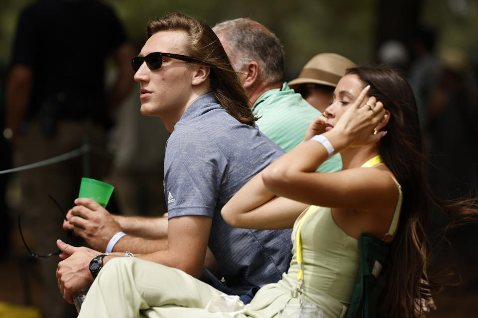 Clemson's Trevor Lawrence, pictured with his now wife Marissa Mowry at the Masters on April 8, was fairly candid in an interview with Sports Illustrated. (Photo by Jared C. Tilton/Getty Images)