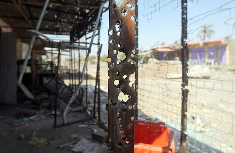 Bullet holes cover a building after heavy fighting between Islamic State group jihadists and Iraqi security forces in Dhuluiya on September 17, 2014 (AFP Photo/Ahmad al-Rubaye)