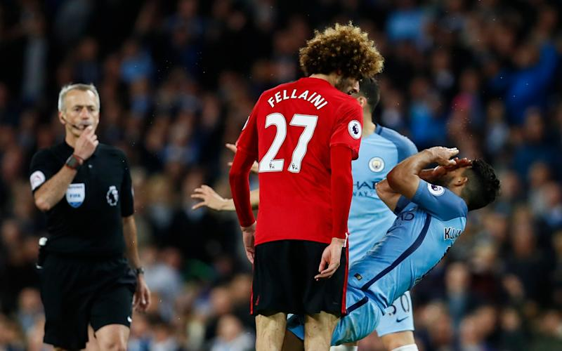 Fellaini was sent off for butting Sanchez - Credit: Jason Cairnduff/REUTERS