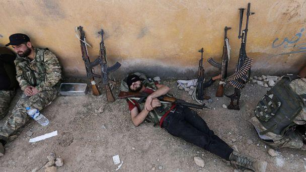 PHOTO: A Turkey-backed Syrian rebel fighter takes a rest near the border town of Tal Abyad, Syria, Oct. 22, 2019. (Khalil Ashawi/Reuters)