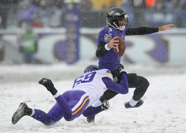 Baltimore Ravens quarterback Joe Flacco is tackled by Minnesota Vikings defensive end Jared Allen as he rushes the ball in the first half of an NFL football game, Sunday, Dec. 8, 2013, in Baltimore. (AP Photo/Gail Burton)