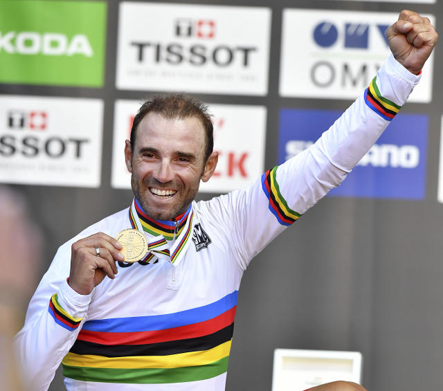 Spain's Alejandro Valverde reacts on the podium after winning the men's road race at the Road Cycling World Championships in Innsbruck, Austria, Sunday, Sept.30, 2018. (AP Photo/Kerstin Joensson)