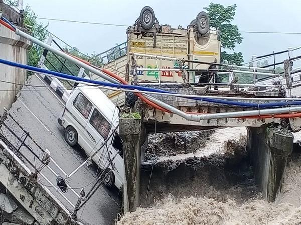 Rescue, relief operations underway after bridge with vehicles on the Dehradun-Rishikesh highway collapses (Photo/ANI)