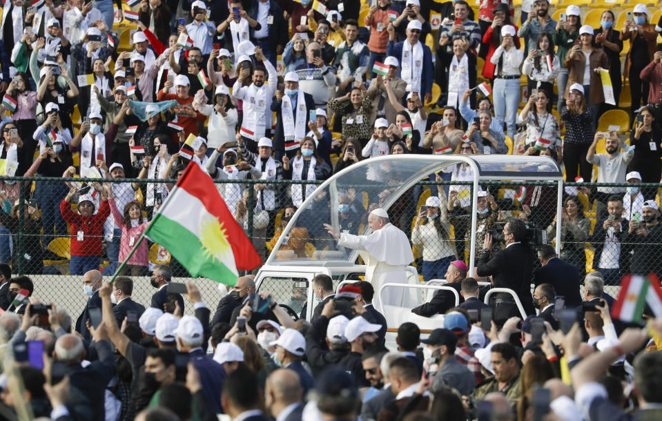 Pope Francis arrives on the popemobile to celebrate mass at the Franso Hariri Stadium in Irbil, Kurdistan Region of Iraq, Sunday, March 7, 2021. The Vatican and the pope have frequently insisted on the need to preserve Iraq's ancient Christian communities and create the security, economic and social conditions for those who have left to return.(AP Photo/Andrew Medichini)