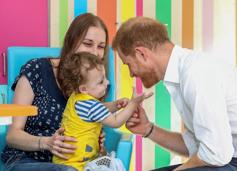 The Duke of Sussex plays with one year old Noah Nicholson during his visit to Sheffield Children's Hospital in Clarkson Street, Sheffield, where he officially opened the new wing.