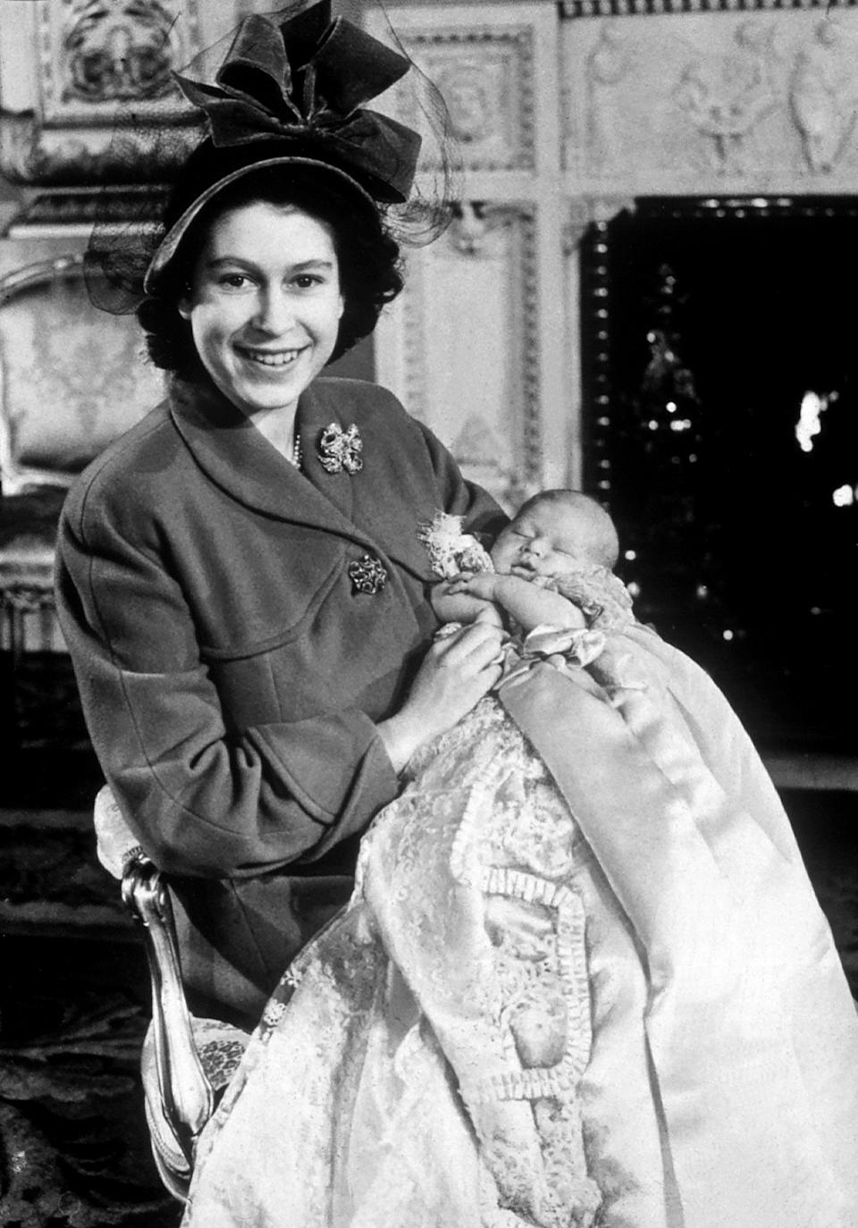 Her Majesty Queen Elizabeth II pictured when she was Princess Elizabeth with her first baby Prince Charles at Christening 1948 weby queen010306 dtgu2 (Photo by mirrorpix/Mirrorpix/Mirrorpix via Getty Images)