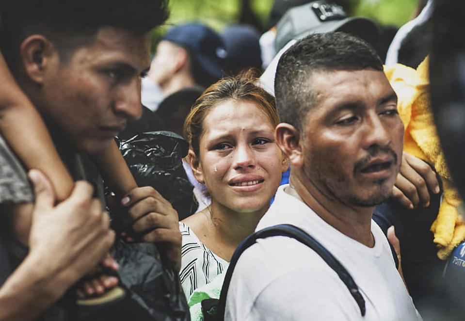 Migrants are detain by Mexican authorities in Tapachula, Chiapas state, Mexico on October 12, 2019. - A caravan of 2,000 migrants, among Central Americans, Caribbean and Africans, began to march this Saturday from Tapachula, in southern Mexico, heading to the capital of the country, to demand President Andres Manuel Lopez Obrador help to get out of their legal limbo. (Photo by Daniel ZACARIAS / AFP) (Photo by DANIEL ZACARIAS/AFP via Getty Images)