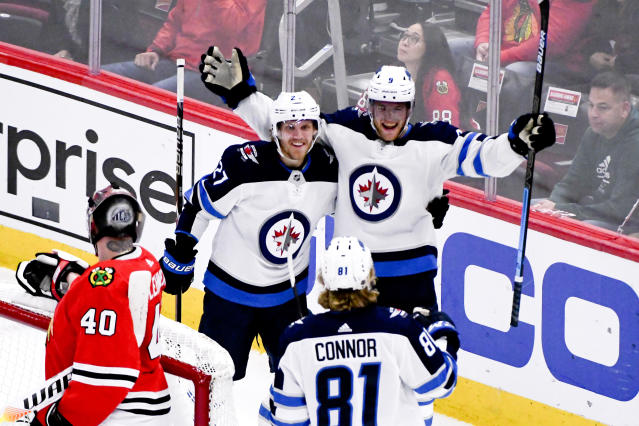 Winnipeg Jets center Andrew Copp (9) celebrates his goal against the Chicago Blackhawks with left wing Nikolaj Ehlers (27) and left wing Kyle Connor (81) during the third period of an NHL hockey game Saturday, Oct. 12, 2019, in Chicago. (AP Photo/Matt Marton)