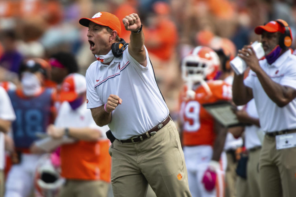 FILE - In this Oct. 24, 2020, file photo, Clemson head coach Dabo Swinney reacts on the sidelines during an NCAA college football game against Syracuse in Clemson, S.C. (Ken Ruinard/Pool Photo via AP, File)