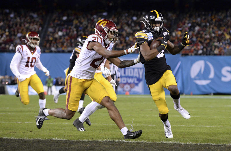 Iowa wide receiver Ihmir Smith-Marsette, right, scores a touchdown ahead of Southern California safety Isaiah Pola-Mao (21) during the first half of the Holiday Bowl NCAA college football game Friday, Dec. 27, 2019, in San Diego. (AP Photo/Orlando Ramirez)