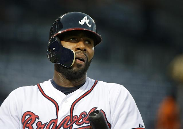 Atlanta Braves' Jason Heyward wears a protective helmet as he steps up to bat in the first inning of a baseball game against the Milwaukee Brewers, Monday, Sept. 23, 2013, in Atlanta. Heyward sustained two jaw fractures when he was struck by a 90 mph fastball from New York Mets pitcher Jonathon Niese in a game on Aug. 21, in New York. (AP Photo/David Goldman)