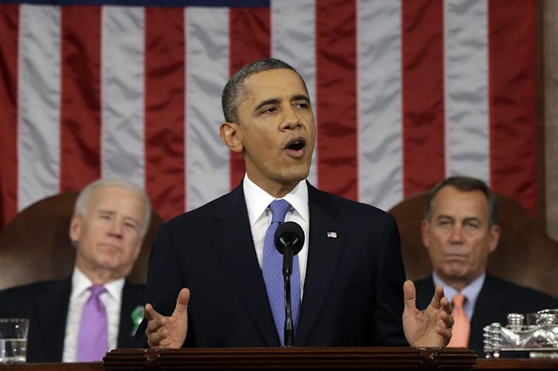 """FILE - This Feb. 12, 2013 file photo shows President Barack Obama, flanked by Vice President Joe Biden and House Speaker John Boehner of Ohio, giving his State of the Union address during a joint session of Congress on Capitol Hill in Washington. It was a moment for Barack Obama to savor. His second inaugural address over, Obama paused as he strode from the podium last January, turning back for one last glance across the expanse of the National Mall, where a supportive throng stood in the winter chill to witness the launch of his new term. """"I want to take a look, one more time,"""" Obama said quietly. """"I'm not going to see this again.""""There was so much Obama could not _ or did not _ see then, as he opened his second term with a confident call to arms and an expansive liberal agenda. (AP Photo/Charles Dharapak, File-Pool)"""
