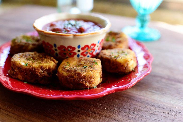 """<p>Whether you throw it on a salad or eat it by itself, this cheesy snack can't be beat. </p><p><strong><a href=""""https://thepioneerwoman.com/cooking/fried-goat-cheese/"""" rel=""""nofollow noopener"""" target=""""_blank"""" data-ylk=""""slk:Get the recipe"""" class=""""link rapid-noclick-resp"""">Get the recipe</a>.</strong></p><p><strong><strong><a class=""""link rapid-noclick-resp"""" href=""""https://go.redirectingat.com?id=74968X1596630&url=https%3A%2F%2Fwww.walmart.com%2Fip%2FPioneer-Woman-Pink-Botanical-Paper-Luncheon-Napkins-48ct%2F822157941&sref=https%3A%2F%2Fwww.thepioneerwoman.com%2Ffood-cooking%2Fmeals-menus%2Fg32157273%2Ffourth-of-july-appetizers%2F"""" rel=""""nofollow noopener"""" target=""""_blank"""" data-ylk=""""slk:SHOP DISPOSABLE NAPKINS"""">SHOP DISPOSABLE NAPKINS</a></strong><br></strong></p>"""