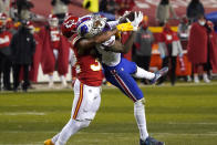 Buffalo Bills wide receiver Stefon Diggs is tackled by Kansas City Chiefs safety Tyrann Mathieu, left, after catching a pass during the second half of the AFC championship NFL football game, Sunday, Jan. 24, 2021, in Kansas City, Mo. (AP Photo/Jeff Roberson)