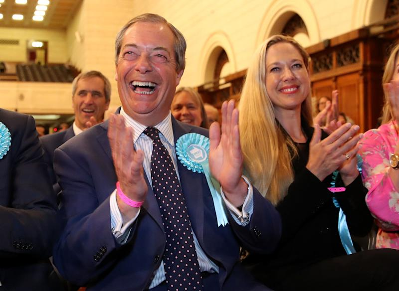 Brexit Party leader Nigel Farage (left) celebrates being elected after the European Parliamentary elections count at the Guildhall in Southampton.