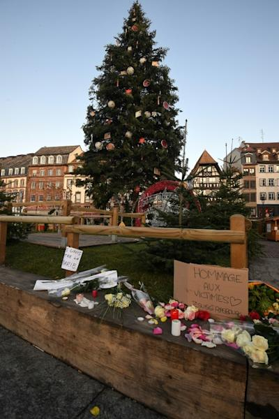 Flowers and candles were placed on Strasbourg's Place Kleber on Wednesday in tribute to the victims of the terror attack at the city's bustling Christmas market