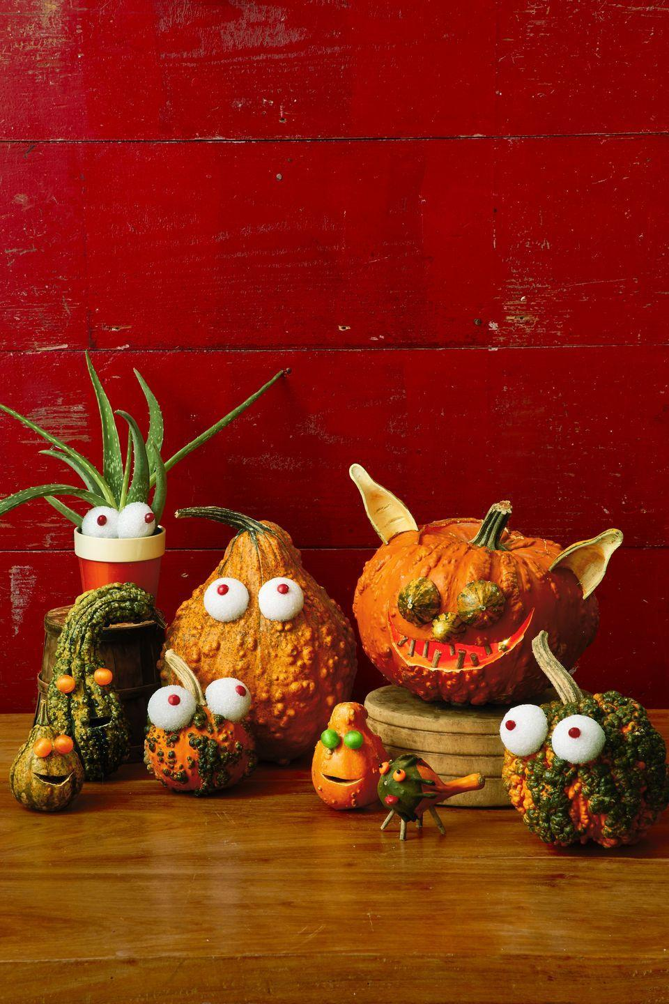 <p>For this motley crew, bumpy, odd-shaped gourds take center stage. To make eyeballs, cut small Styrofoam balls in half, then hot-glue hard candy in the center; attach with pins or hot glue. Hollow out gourds for ears. Use twigs for teeth and legs.<br></p>