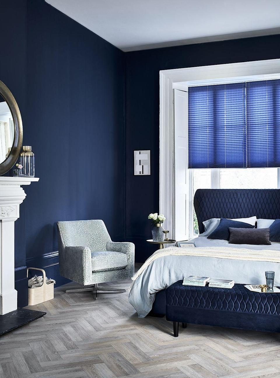 """<p>Create a Soho-inspired luxe bedroom vibe with <a href=""""https://www.dreams.co.uk/grove-velvet-finish-upholstered-ottoman-bed-frame/p/251-00336"""" rel=""""nofollow noopener"""" target=""""_blank"""" data-ylk=""""slk:Grove"""" class=""""link rapid-noclick-resp"""">Grove</a> from the House Beautiful Collection at Dreams. Sumptuous, velvet-textured, quilted upholstery in rich royal blue sets the seductive scene, creating a sleeping space that's restful and alluring in equal measure. Complete the opulent look with a matching plush <a href=""""https://www.dreams.co.uk/grove-1-drawer-usb-charging-bedside-chest/p/810-00148"""" rel=""""nofollow noopener"""" target=""""_blank"""" data-ylk=""""slk:bedside chest"""" class=""""link rapid-noclick-resp"""">bedside chest</a>, <a href=""""https://www.dreams.co.uk/grove-blanket-box/p/020-01173"""" rel=""""nofollow noopener"""" target=""""_blank"""" data-ylk=""""slk:blanket box"""" class=""""link rapid-noclick-resp"""">blanket box</a> and <a href=""""https://www.dreams.co.uk/grove-bench/p/020-01177"""" rel=""""nofollow noopener"""" target=""""_blank"""" data-ylk=""""slk:bench"""" class=""""link rapid-noclick-resp"""">bench</a>.</p><p><a class=""""link rapid-noclick-resp"""" href=""""https://www.dreams.co.uk/grove-velvet-finish-upholstered-ottoman-bed-frame/p/251-00336"""" rel=""""nofollow noopener"""" target=""""_blank"""" data-ylk=""""slk:SHOP NOW"""">SHOP NOW</a></p><p>The House Beautiful Grove is available as a double, king or superking ottoman bed for extra storage, or with Sleepmotion, so you can adjust the bed to your ultimate position for maximum comfort. Check out the full range at <a href=""""https://www.dreams.co.uk/house-beautiful"""" rel=""""nofollow noopener"""" target=""""_blank"""" data-ylk=""""slk:dreams.co.uk/housebeautiful"""" class=""""link rapid-noclick-resp"""">dreams.co.uk/housebeautiful</a>.</p><p><strong>Style Tips for creating the Soho Escape look:</strong></p><p>• Varying cushion sizes and shapes on your bed adds interest and prevents a regimented look.</p><p>• Bold, dark wall colours create a cosy, intimate space, perfect for bedrooms. Freshen the look with white-painted woodwor"""