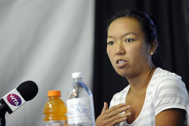 Vania King speaks to the media at the Citi Open tennis tournament, Friday, Aug. 1, 2014, in Washington. King withdrew from the tournament due to an injury. (AP Photo/Nick Wass)