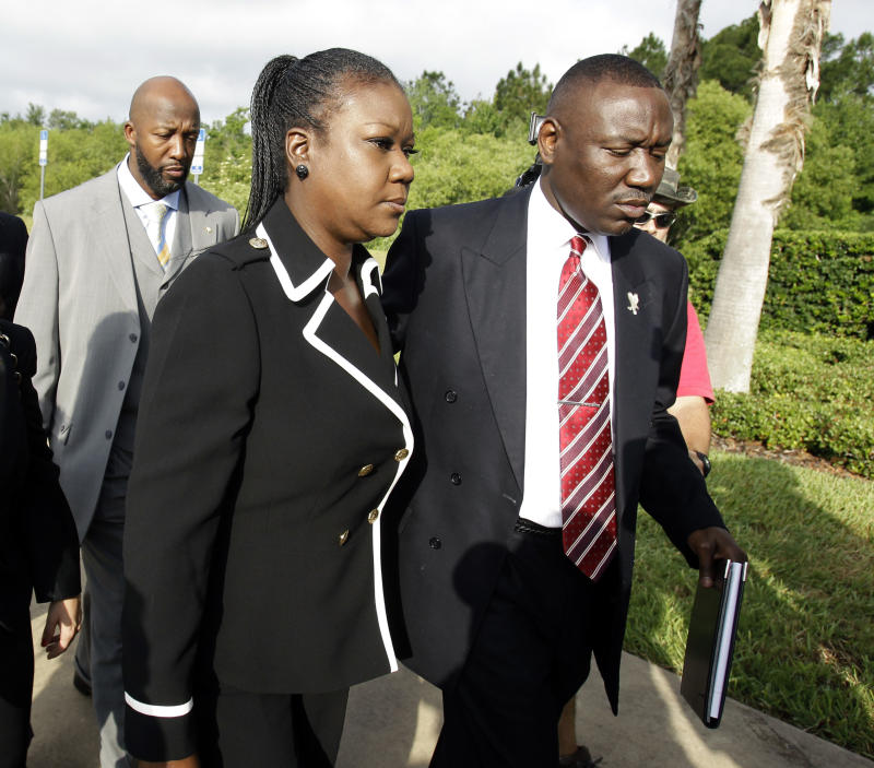 Tracy Martin, back left, Sybrina Fulton, center, parents of Trayvon Martin, and attorney Benjamin Crump, arrive at the Seminole County Criminal Justice Center for a bond hearing for George Zimmerman,  the neighborhood watch volunteer charged with murdering Trayvon Martin, Friday, April 20, 2012, in Sanford, Fla.  Attorney for Zimmerman, Mark O'Mara is asking the Seminole County judge to let Zimmerman post bail at the hearing Friday. (AP Photo/John Raoux)