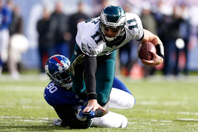 <p>Jason Pierre-Paul #90 of the New York Giants tackles Carson Wentz #11 of the Philadelphia Eagles during the first quarter of the game at MetLife Stadium on November 6, 2016 in East Rutherford, New Jersey. (Photo by Jeff Zelevansky/Getty Images) </p>
