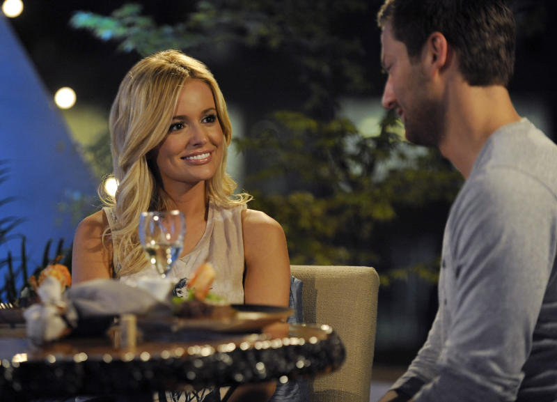 """In this March 20, 2012 image released by ABC, Emily Maynard, left is shown on """"The Bachelorette,"""" in Charlotte, N.C. Maynard talks about what she's doing differently this time around as ABC's """"Bachelorette."""" She got engaged last year to Brad Womack in the season finale of """"The Bachelor"""" but their relationship didn't work out. (AP Photo/ABC, Angeline Herron)"""
