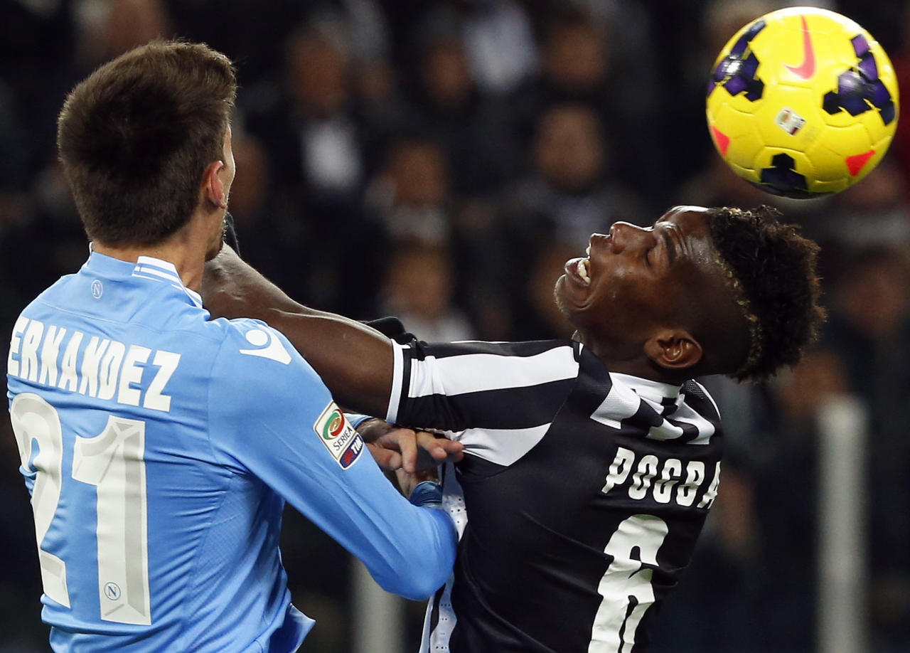 Juventus' Paul Pogba (R) fights for the ball with Napoli's Federico Fernandez during their Italian Serie A soccer match at the Juventus stadium in Turin November 10, 2013. REUTERS/Stefano Rellandini (ITALY - Tags: SPORT SOCCER)
