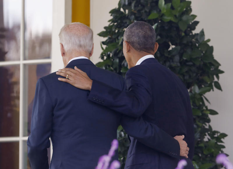 FILE - In this Nov. 9, 2016, file photo, President Barack Obama and Vice President Joe Biden, with their arms on each other, walk back to the Oval Office of the White House in Washington, after the president spoke about the election in the Rose Garden. Nearly eight years after he was last on the ballot, Obama is emerging as a central figure in the 2020 presidential election. Democrats are eagerly embracing Obama as a political wingman for Joe Biden, who spent two terms by his side as vice president. Obama remains the party's most popular figure, particularly with black voters and younger Democrats. (AP Photo/Pablo Martinez Monsivais, File)