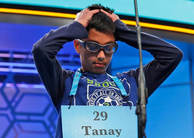 <p>Tanay Nandan, 10, from Short Hills, N.J., thinks about his word in the third round of the 90th Scripps National Spelling Bee, Wednesday, May 31, 2017, in Oxon Hill, Md. Nandan spelled his word correctly. (AP Photo/Alex Brandon) </p>