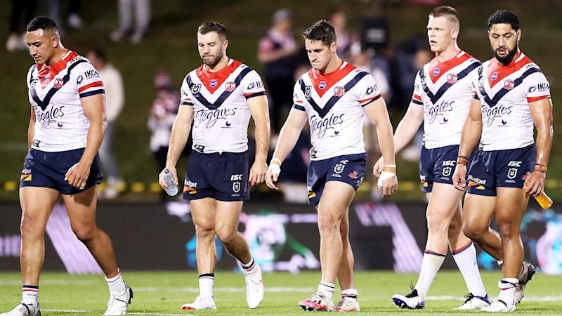 Sydney Roosters players are pictured walking off the field after their loss to Penrith.