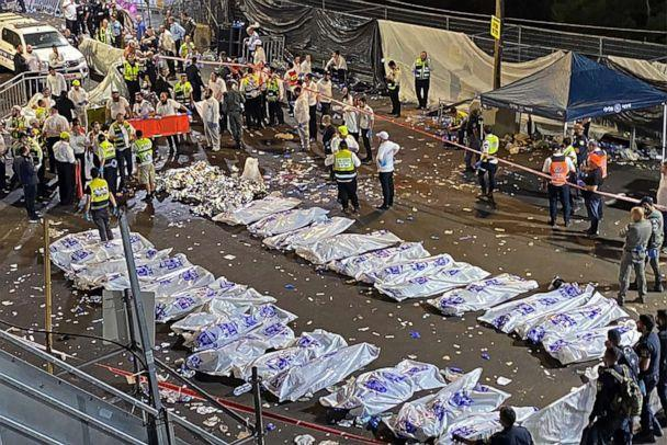 PHOTO: Security officials and rescuers gather near the bodies of victims who died in a stampede overnight during a religious gatheringin northern Israel, during a religious gathering. (Behadrei Haredim/United Hatzalah via AFP via Getty Images)