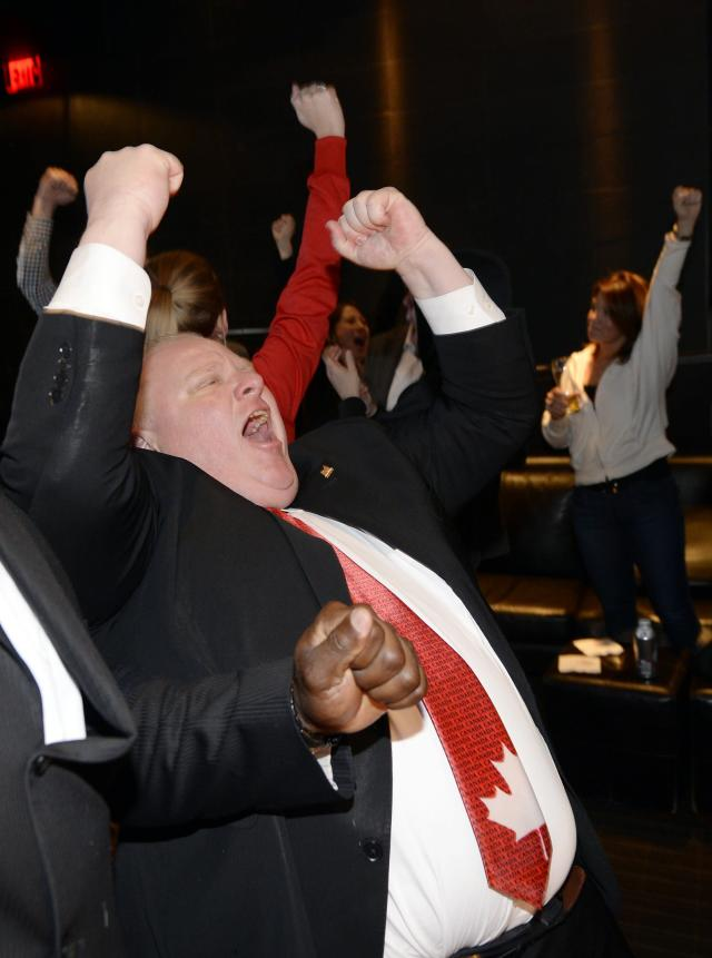 Toronto Mayor Rob Ford celebrates Canada's win over Team USA at their men's ice hockey semi-final game at the Sochi 2014 Winter Olympic Games, while watching a televised broadcast of the game in Toronto February 21, 2014. REUTERS/Aaron Harris (CANADA - Tags: POLITICS SPORT OLYMPICS ICE HOCKEY)