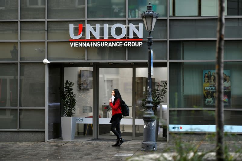 People walk past insurance company Union HQ in Budapest