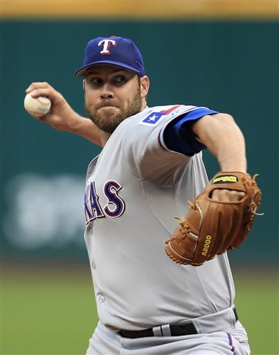 Texas Rangers starting pitcher Colby Lewis pitches in the first inning in a baseball game against the Cleveland Indians, Friday, May 4, 2012, in Cleveland. (AP Photo/Tony Dejak)