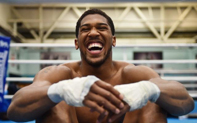 <span>Anthony Joshua takes a break from training in Sheffield </span> <span>Credit: Getty Images </span>