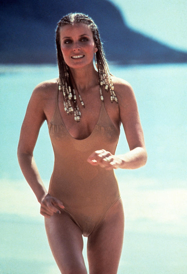 """<b>Hit: Jenny Hanley (Bo Derek) in '<a href=""""http://movies.yahoo.com/movie/10/"""">10</a>'</b><br /><br />Director Blake Edwards knew what was going to sell his 1979 comedy classic: the image of Bo Derek jogging along the beach in a yellow bathing suit. Derek's Jenny Hanley made for the seemingly perfect solution to the midlife crisis of Dudley Moore's George Webber, and soon she became the Queen Dream Girl of all of pop culture-dom. <br /><br />"""