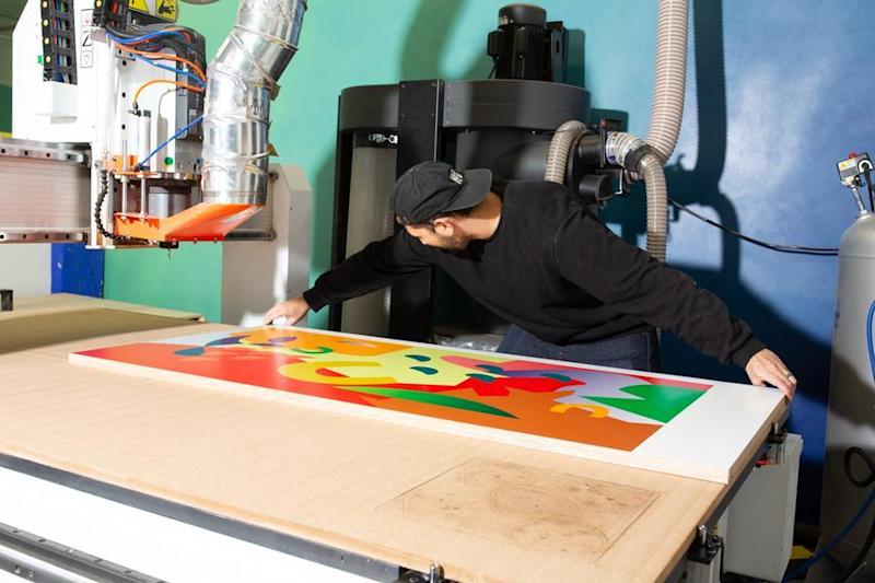 A Chassie designer works hard on a colorful desktop inside the company's Bronx, NY studio.