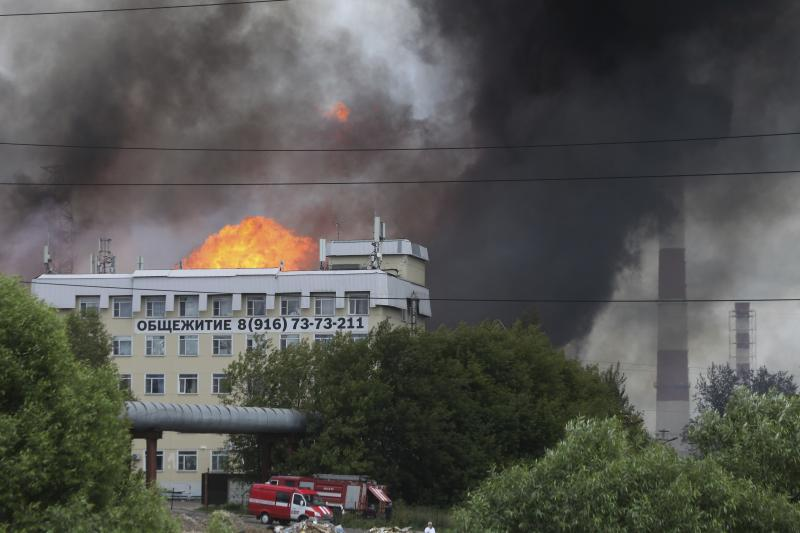 Black smoke and flames rise over a power station, in Mytishchi, outside Moscow, Russia, Thursday, July 11, 2019.The fire broke out on Thursday on the premises of a power station just outside Moscow, injuring five people. ( Sergey Vedyashkin, Moscow News Agency photo via AP)