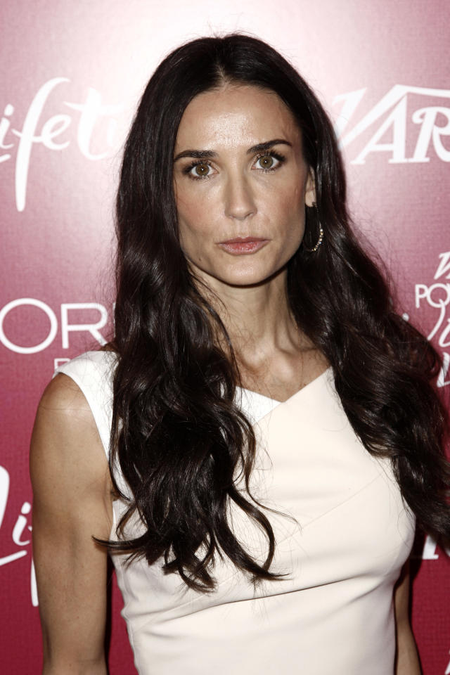 "Demi Moore arrives at Variety's 3rd Annual Power of Women Luncheon in Beverly Hills, Calif., in this Sept. 23, 2011 photo. A 911 recording released Friday Jan. 27, 2012 by Los Angeles fire officials revealed frantic efforts by friends of Demi Moore to get help for the actress who was convulsing as they gathered around her and tried to comfort her. Moore was ""semi-conscious, barely,"" according to a female caller on the recording. (AP Photo/Matt Sayles)"