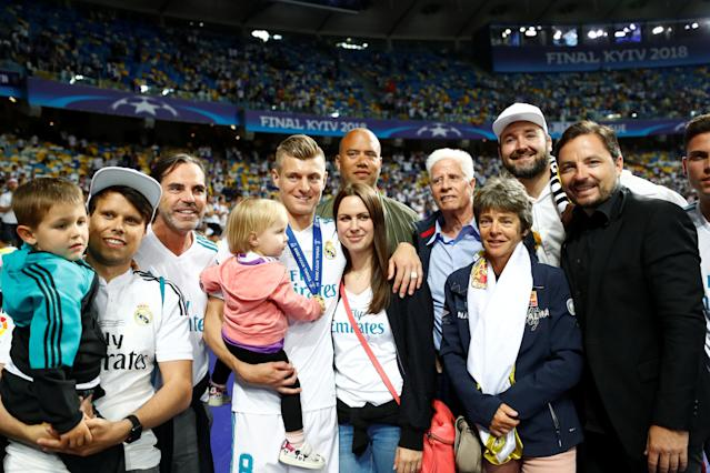 Soccer Football - Champions League Final - Real Madrid v Liverpool - NSC Olympic Stadium, Kiev, Ukraine - May 26, 2018 Real Madrid's Toni Kroos poses with his family as he celebrates winning the Champions League REUTERS/Kai Pfaffenbach