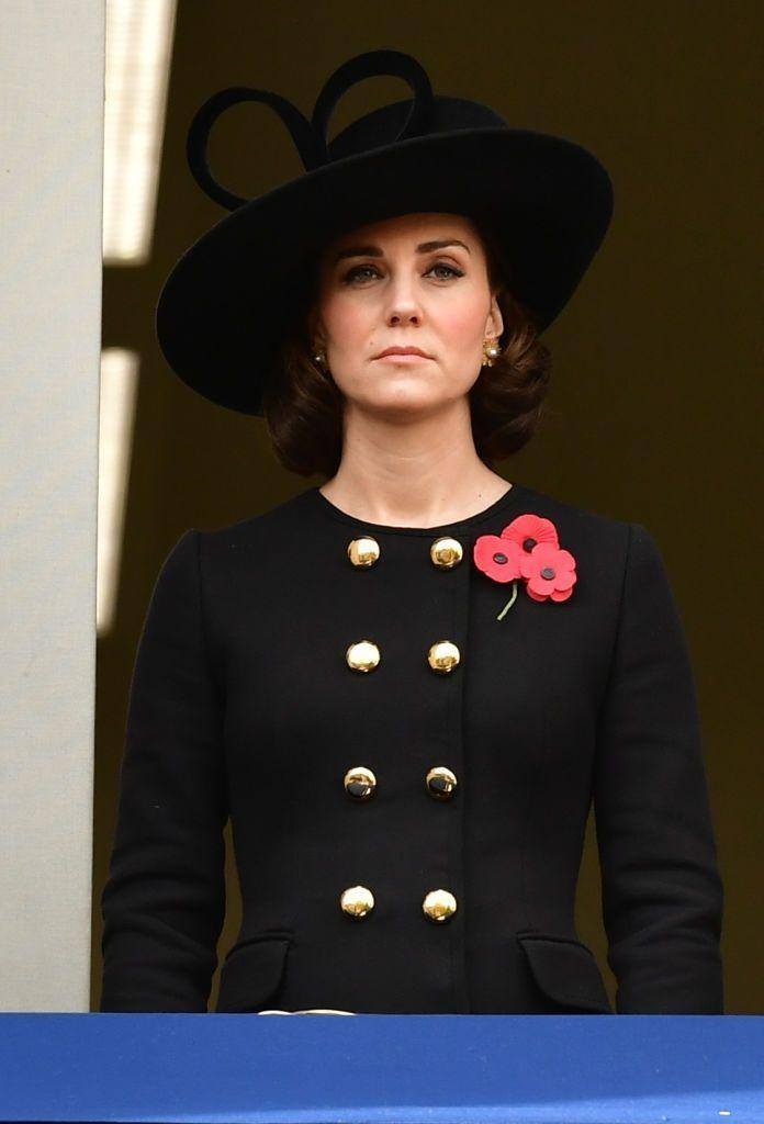 """<p>Kate wore a black Dolce & Gabbana coat dress to the somber Remembrance Day ceremony, which honors fallen soldiers. She paired the chic black outfit with a black hat, <a href=""""https://www.townandcountrymag.com/leisure/arts-and-culture/a10392338/what-is-remembrance-day-and-poppy-pin-badges/"""" rel=""""nofollow noopener"""" target=""""_blank"""" data-ylk=""""slk:a poppy pin"""" class=""""link rapid-noclick-resp"""">a poppy pin</a>, and a new short hairstyle, which was later revealed <a href=""""https://www.townandcountrymag.com/society/tradition/g12167293/kate-middleton-best-maternity-outfits/"""" rel=""""nofollow noopener"""" target=""""_blank"""" data-ylk=""""slk:to be a faux-bob"""" class=""""link rapid-noclick-resp"""">to be a faux-bob</a>.</p>"""
