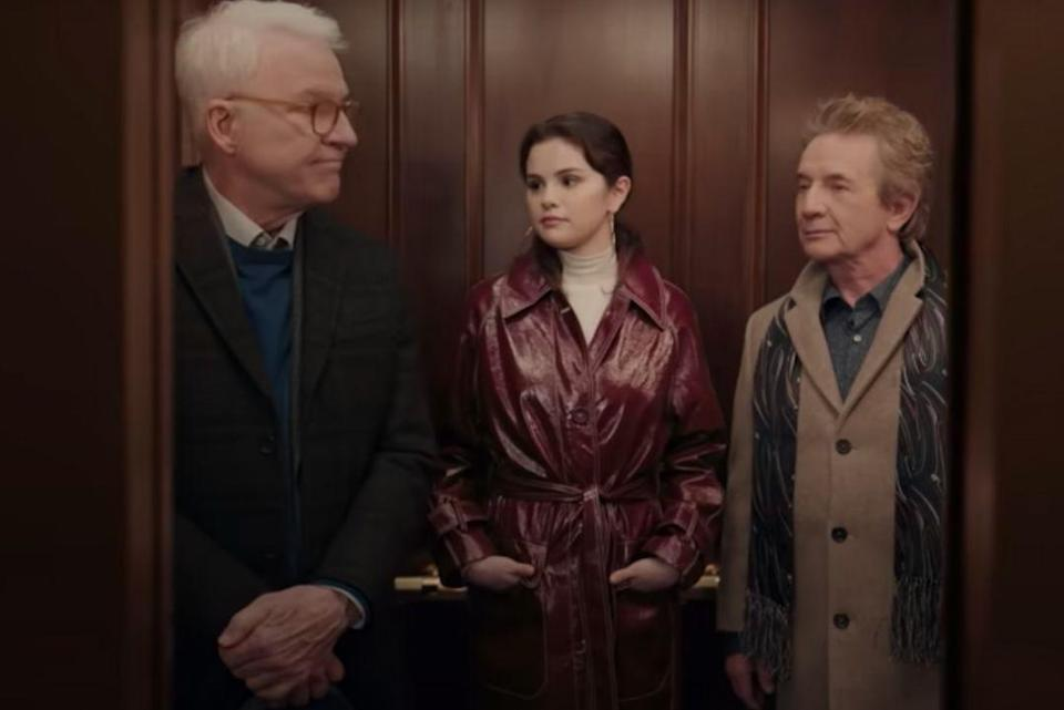 """<p>Covarrubias tells us it's her favourite outfit of Mabel's from the series is this one: 'The look is very 70's badass detective. I love how it feels very modern and very classic at the same time- this was the aesthetic we wanted for the entire show.'</p><p>The wine coloured coat is from Asos, the turtleneck cream sweater is & Other Stories and there's a two piece Beige Frankie Shop suit under that coat too. </p><p><a class=""""link rapid-noclick-resp"""" href=""""https://go.redirectingat.com?id=127X1599956&url=https%3A%2F%2Fwww.stories.com%2Fen_gbp%2Fclothing%2Fknitwear%2Fturtlenecks%2Fproduct.merino-wool-turtleneck-white.0679490004.html&sref=https%3A%2F%2Fwww.elle.com%2Fuk%2Ffashion%2Fcelebrity-style%2Fg37396246%2Fselena-gomez-only-murders-in-the-building%2F"""" rel=""""nofollow noopener"""" target=""""_blank"""" data-ylk=""""slk:SHOP NOW"""">SHOP NOW </a> Merino Wool Turtleneck, £55</p><p><a class=""""link rapid-noclick-resp"""" href=""""https://go.redirectingat.com?id=127X1599956&url=https%3A%2F%2Fwww.farfetch.com%2Fuk%2Fshopping%2Fwomen%2Ffrankie-shop-isla-wide-leg-trouser-item-16395704.aspx&sref=https%3A%2F%2Fwww.elle.com%2Fuk%2Ffashion%2Fcelebrity-style%2Fg37396246%2Fselena-gomez-only-murders-in-the-building%2F"""" rel=""""nofollow noopener"""" target=""""_blank"""" data-ylk=""""slk:SHOP NOW"""">SHOP NOW </a>The Frankie Shop Isla Wide-Leg Trouser, £205<br></p>"""