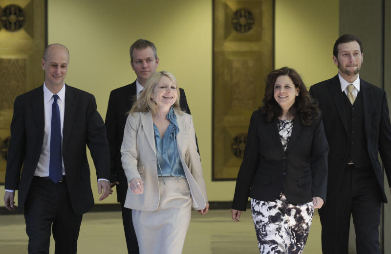 Amy Thompson, second from right, defense attorney for William Balfour, and her team return from hearing a question from the jury during deliberations at Cook County Criminal Court, Friday, May 11, 2012, in Chicago. Balfour, is charged in the 2008 murder of Oscar and Grammy winning performer Jennifer Hudson's mother, brother and nephew. (AP Photo/M. Spencer Green)