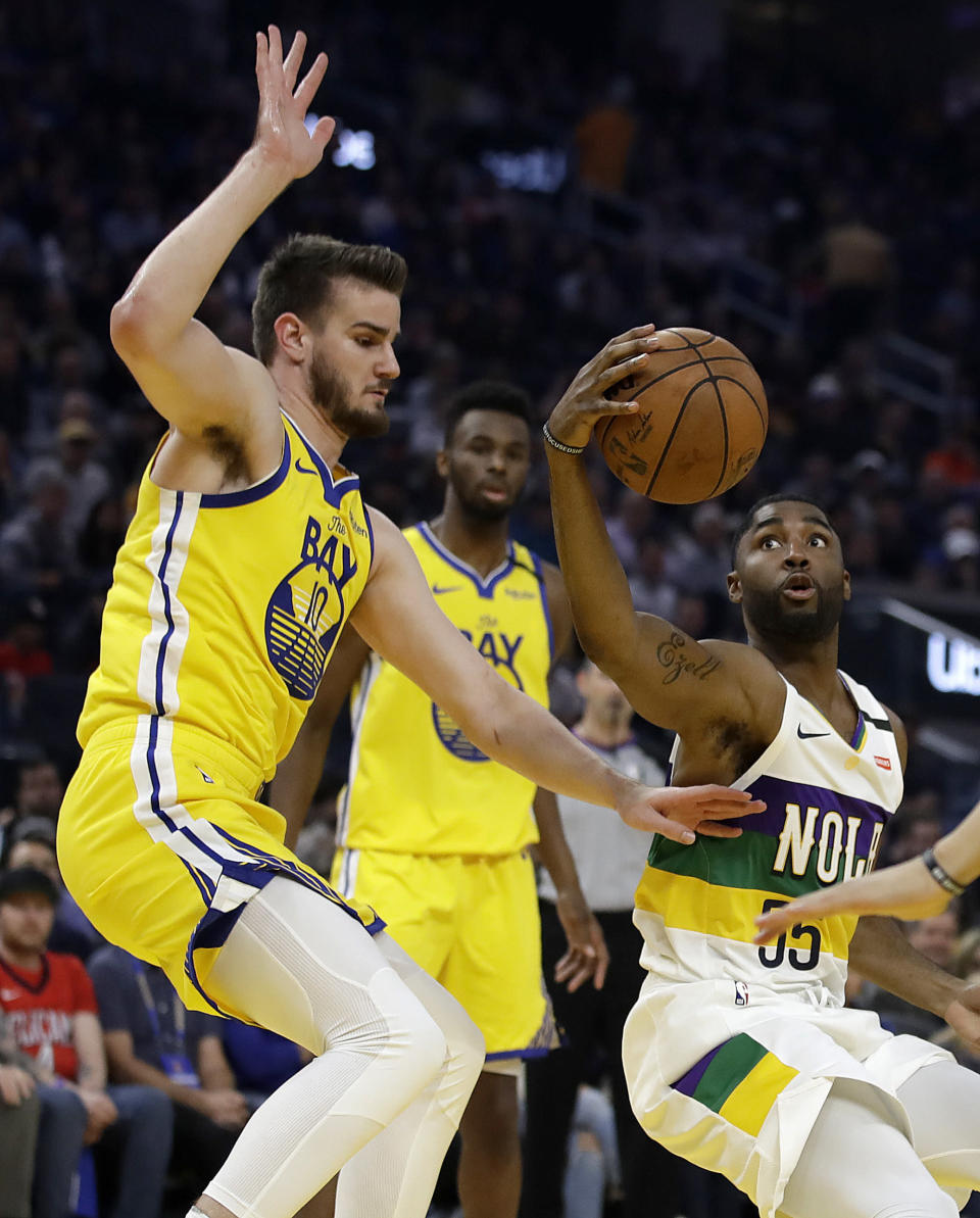New Orleans Pelicans' E'Twaun Moore, right, drives the ball against Golden State Warriors' Dragon Bender (10) during the first half of an NBA basketball game Sunday, Feb. 23, 2020, in San Francisco. (AP Photo/Ben Margot)