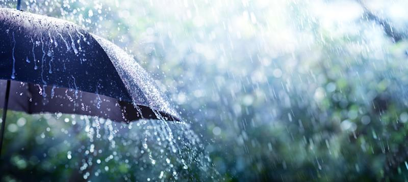 Rain On Umbrella - Weather Concept (Photo: RomoloTavani via Getty Images)