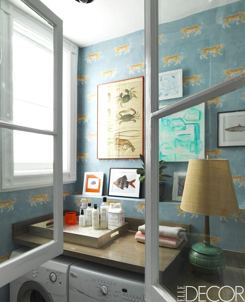 """<p>The laundry room of a <a href=""""https://www.elledecor.com/design-decorate/house-interiors/"""" rel=""""nofollow noopener"""" target=""""_blank"""" data-ylk=""""slk:Brooklyn home"""" class=""""link rapid-noclick-resp"""">Brooklyn home</a> makes a playful statement with cheetah wallpaper by <a class=""""link rapid-noclick-resp"""" href=""""http://www.caitlinmcgauley.com/"""" rel=""""nofollow noopener"""" target=""""_blank"""" data-ylk=""""slk:Caitlin McGauley"""">Caitlin McGauley</a>. The crab print is vintage and the abstract artwork is by <a class=""""link rapid-noclick-resp"""" href=""""http://www.waywayallen.com/"""" rel=""""nofollow noopener"""" target=""""_blank"""" data-ylk=""""slk:Way Way Allen"""">Way Way Allen</a>.</p><p><em>Silent Tiger Wallpaper, $188</em><br><a class=""""link rapid-noclick-resp"""" href=""""https://go.redirectingat.com?id=74968X1596630&url=https%3A%2F%2Fwww.anthropologie.com%2Fshop%2Fsilent-tiger-wallpaper%3Fcolor%3D041%26size%3DOne%2BSize%26inventoryCountry%3DUS%26countryCode%3DUS%26mrkgcl%3D694%26mrkgadid%3D3339968734%26adtype%3Dpla%26product_id%3D47734553%26adpos%3D1o2%26creative%3D348156566303%26device%3Dc%26network%3Dg%26gclid%3DCjwKCAjw8NfrBRA7EiwAfiVJpYVhTZOu6-7t0GdTpGHQNwt5QXNTTm45s2Xv65ivCd0Nlbwg6IJSLBoCFC8QAvD_BwE%26gclsrc%3Daw.ds%26type%3DSTANDARD%26quantity%3D1&sref=https%3A%2F%2Fwww.redbookmag.com%2Fhome%2Fg35083191%2Fwallpaper-design-ideas%2F"""" rel=""""nofollow noopener"""" target=""""_blank"""" data-ylk=""""slk:Shop the Look"""">Shop the Look</a></p>"""