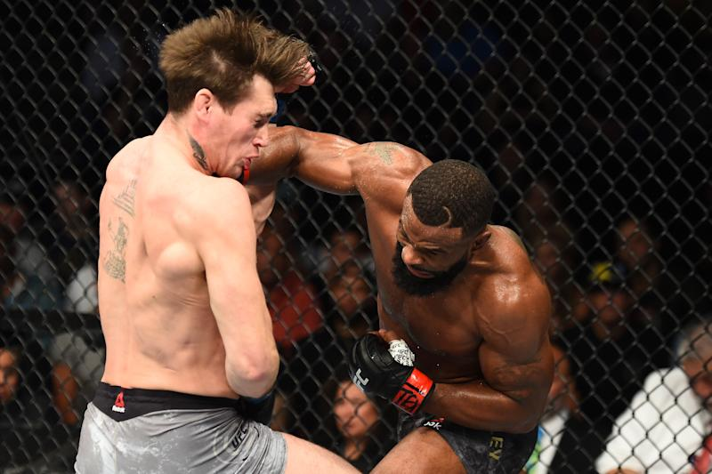 DALLAS, TX - SEPTEMBER 08: (R-L) Tyron Woodley punches Darren Till of England in their UFC welterweight championship fight during the UFC 228 event at American Airlines Center on September 8, 2018 in Dallas, Texas. (Photo by Josh Hedges/Zuffa LLC/Zuffa LLC via Getty Images)