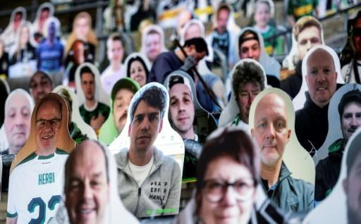 Borussia Moenchegladbach supporters can appear as cardboard cutouts at their stadium
