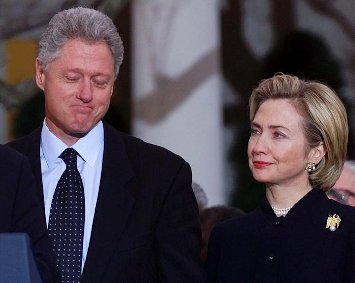 <p>President Bill Clinton and first lady Hillary Rodham Clinton listen outside the Oval Office in December 1998 to Vice President Al Gore's remarks to Democratic lawmakers about the president's years in office. In a historic vote, the House of Representatives voted to impeach the president. (Photo: Doug Mills/AP)</p>
